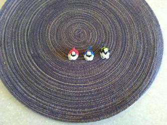 Poke Ball Charms by StyxxsOmega