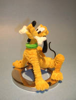 Pluto by fuzzymutt