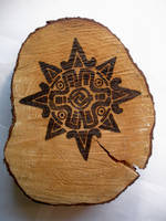 Wood Burnt Sun Symbol by AliDee33