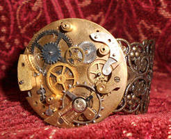 Clockwork filigree bracelet by lilvoodoo
