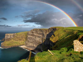 Cliffs of Moher with rainbow by pixllmania