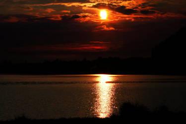 Sunset at Lake Hopfen by AngelEowyn