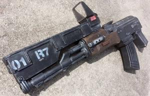 Custom Elysium-inspired AK-47 rifle prop by firebladecomics