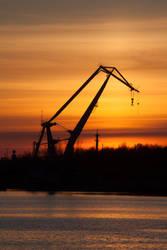 Harbor-crane at sunset by JoergJohannMueller