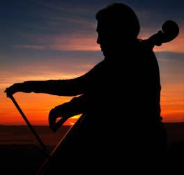 the sunset cellist by VaggelisFragiadakis
