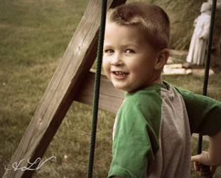 Brandon on the Swings by alexislind