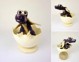 Purple dragon in egg by Koreena