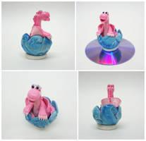 Pink dragon in waves by Koreena