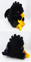 Sleepy yellow eyed black dragon by Koreena