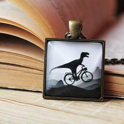 :DINO Bicycle - Dinosaur on bicycle Necklace: by candymax