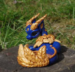 Dragon gold feather by Azura-Roselion