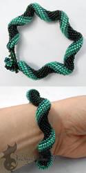 Dark Green Spiral Bracelet by TheWingedShadow