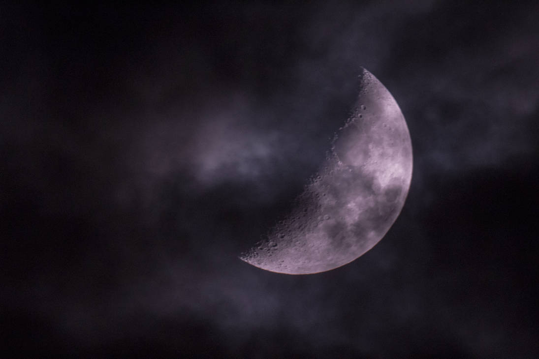Moon photography through a window and a telescope with cloudy weather