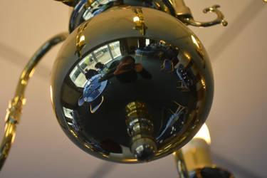 Self Portrait in a Brass Light Fitting by Clangston