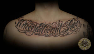 chicano lettering chest unconditional love by 2Face-Tattoo