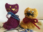 A couple of crocheted cats by Geena93