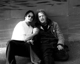 two guys on the street by Kiota