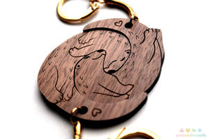 Interlocking Signifigant Otters Wooden Keychain by pookat