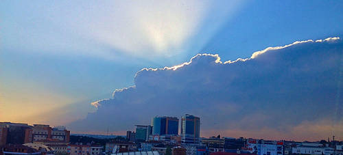Shining between clouds by Primus0123