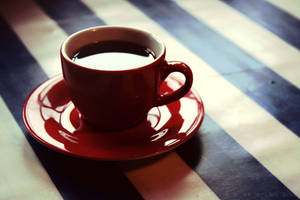 a red cup of coffee by lilleGekko