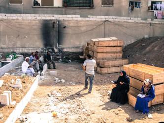 Grieving family in cemetary Yarmouk Damascus Syria by kingtobbe