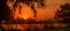burning sunrise by LotusOnlineDe
