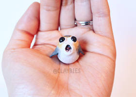 A Palm Sized Porg by lonelysouthpaw