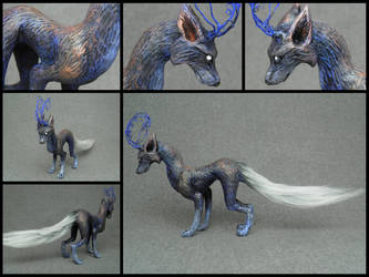 blue and copper antlered fantasy creature by Neronai