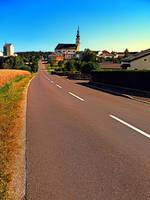 Village road in summertime by patrickjobst