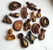 Baltic amber and wood pendants by AmberSculpture