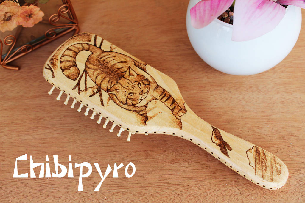Wooden hairbrush wild cat by ChibiPyro