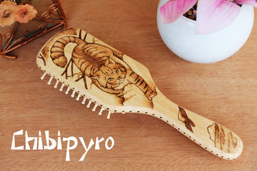 Wooden hairbrush wild cat by ChibiPyro