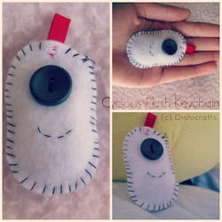 . mini cyclops plush keychain . by oishicrafts