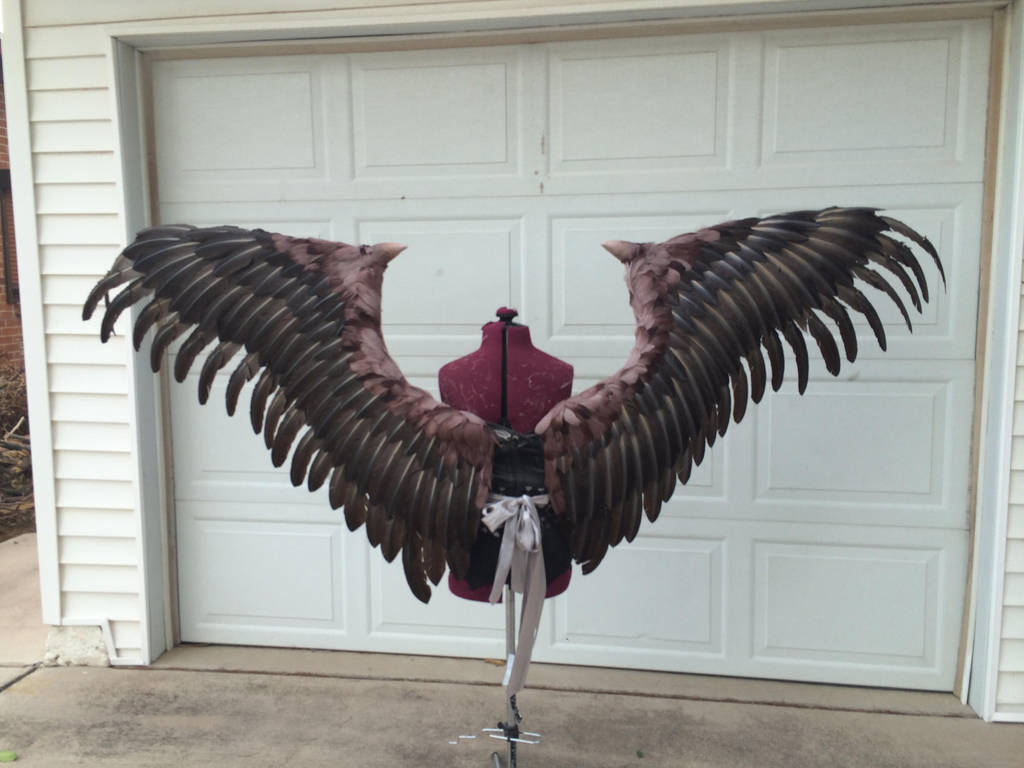 Maleficent wings back by TheGriffinQueen