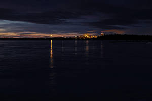 Paper mill behind the icy bay by wchild