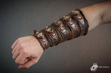 Postapocalyptic hunter bracer with trophies by Tharrk