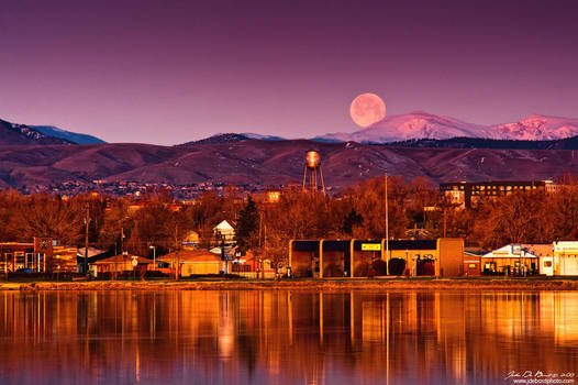 Moonset Over The Rockies by kkart