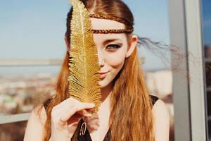 Golden feather by Lileinaya