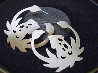 Squid hoop Earrings by bionic-dingo