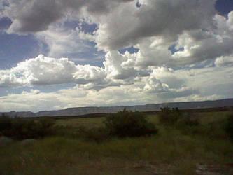 Cloudy Sky by RemnantXXX