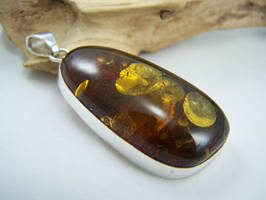 Gold flaked amber pendant by MadOnion1