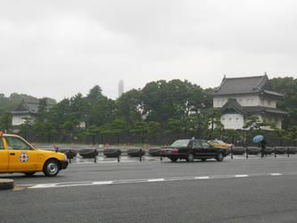 Hibiya-dori Taxis Passing Tokyo Imperial Palace by rlkitterman
