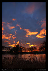 Sunset above pond by semik