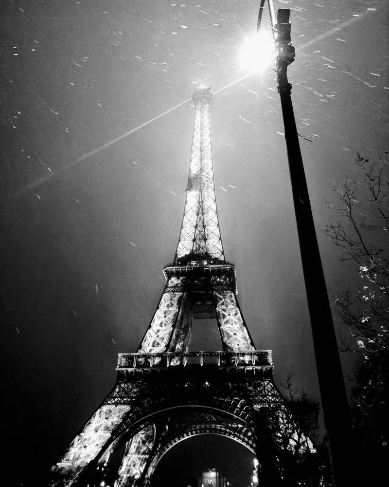 Dramatic Eiffel Tower at night by simonknittel