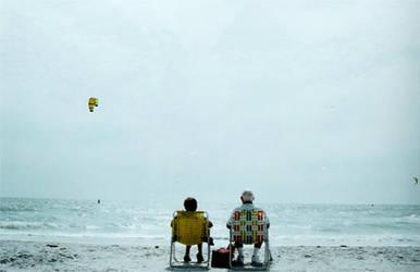 watching kite surfers by idrawnaked