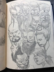 Page full of heads by KenWongArt