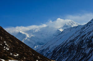 Annapurna Circuit - Day 7- Clouds over the Range by LLukeBE