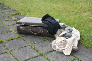 Suitcase and clothes by frozt-stock