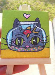 Cat with fish bowl by KatM0nster