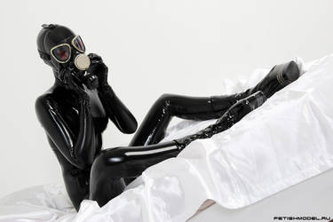 Black Latex Rubber Girl in a White Room. 52 by agnadeviphotographer
